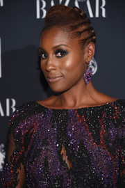 Issa Rae styled her hair into a cornrow updo for the Harper's Bazaar Icons event.
