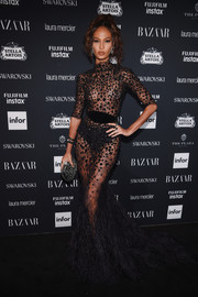 Joan Smalls smoldered in a sheer feather-hem gown by Zuhair Murad Couture at the Harper's Bazaar Icons event.