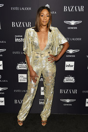 Tiffany Haddish caught eyes in a metallic jumpsuit with a plunging neckline at the 2018 Harper's Bazaar Icons event.