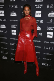 Cindy Bruna completed her effortlessly stylish look with a red A-line leather skirt and matching boots.
