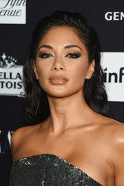 Nicole Scherzinger attended the 2018 Harper's Bazaar Icons event wearing a loose, subtly wavy hairstyle.