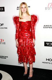 Elle Fanning completed her outfit with a pair of sparkly Louboutins.