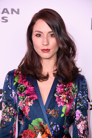 Troian Bellisario showed off stylish bouncy waves at the Harper's Bazaar 150 Most Fashionable Women celebration.