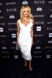 Pamela Anderson looked simply chic in an origami-appliqued LWD by Gauri & Nainika at the Harper's Bazaar Icons event.