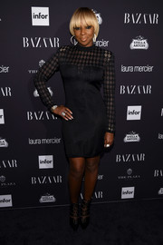 Mary J. Blige attended the Harper's Bazaar Icons event wearing a Balmain LBD with a harlequin-patterned yoke and sleeves.