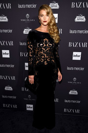 Nina Agdal oozed sultry glamour in a black Zuhair Murad velvet gown with a see-through midsection during the Harper's Bazaar Icons event.
