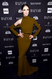 Coco Rocha brought her ultra-modern style to the Harper's Bazaar Icons event with this brown cold-shoulder turtleneck gown.