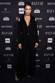 Adriana Lima went for menswear-inspired elegance in a black Yigal Azrouel pantsuit with shoulder cutouts during the Harper's Bazaar Icons event.