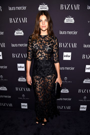 Julia Restoin-Roitfeld took style notes from her mother, Carine, and went sheer as well with this black lace number for the Harper's Bazaar Icons event.