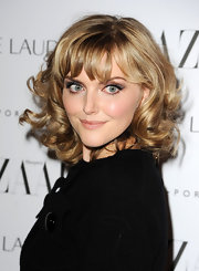 Sophie Dahl wore her shiny locks in a halo of golden curls at the 2011 'Harper's  Bazaar' Women of the Year Awards.