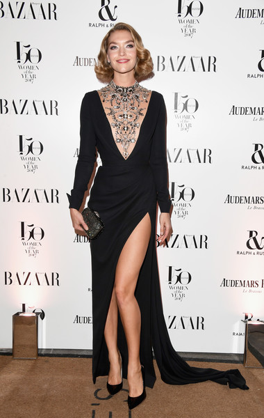 Arizona Muse looked supremely elegant in a black Ralph & Russo Couture gown with a beaded illusion neckline and a thigh-high slit at the Harper's Bazaar Women of the Year Awards.