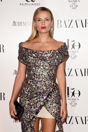 Natasha Poly contrasted her bedazzled dress with a simple black satin clutch when she attended the Harper's Bazaar Women of the Year Awards.
