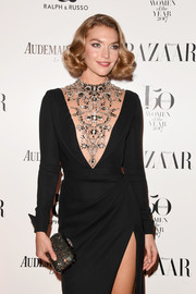 Arizona Muse accessorized with a beaded clutch for some sparkle to her black dress at the Harper's Bazaar Women of the Year Awards.