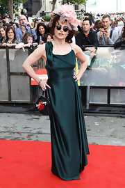 Helena went for her signature quirky red carpet look with a dramatic head piece and an elegant silk emerald evening gown at the UK 'Harry Potter' premiere.