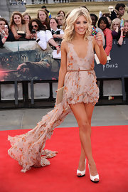 Mollie King opted for two-toned white-and-black peep-toes to complement her romantic floral dress at the final 'Harry Potter' premiere.