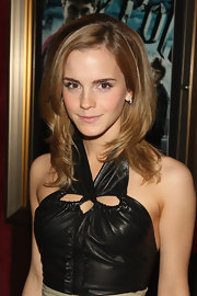 At the premiere of 'Harry Potter and the Half-Blood Prince', Emma Watson turned up the volume on her layered locks.