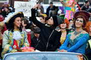 Mila Kunis bundled up in a black zip-up jacket for the Hasty Pudding Theatricals parade.