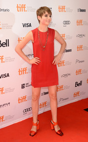 Sami Gayle amped up the retro feel with a pair of chunky-heeled red sandals.