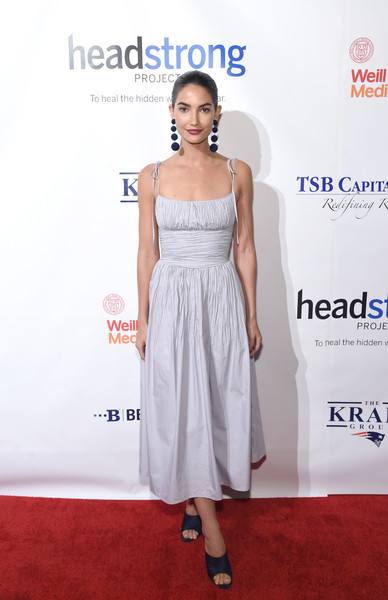 Lily Aldridge pulled her look together with a pair of navy satin slide sandals by Nina Ricci.