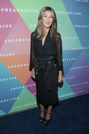 Nina Garcia complemented her blouse with an embellished black pencil skirt.