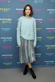 Alexa Chung sealed off her quirky-chic look with a pair of black lace-up boots.