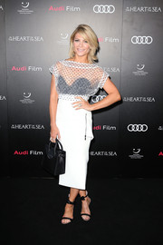 Natalie Bassingthwaighte kept it youthful and trendy in a sheer, dotted crop-top when she attended the Sydney screening of 'In the Heart of the Sea.'