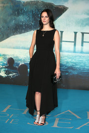 Kaya Scodelario attended the UK premiere of 'In the Heart of the Sea' wearing a sleeveless LBD with long panels of fabric accenting the skirt.
