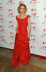 Felicity Huffman dazzled in red at the Heart Truth fall fashion show when she wore this red off-the-shoulder gown with a fitted bodice and full skirt.