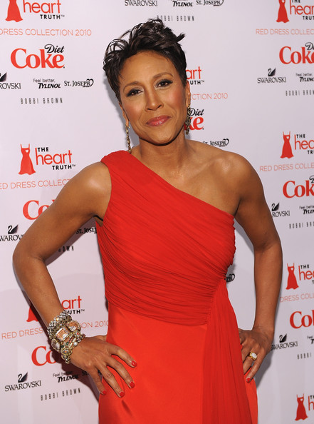 Robin Roberts boldly accessorized with layers of gemstone bracelets at the Heart Truth Red Dress fashion show.