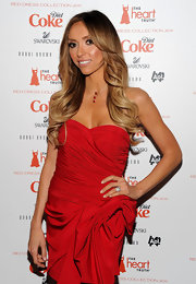Giuliana matched her ravishing red gown to a three string necklace with tiny red hearts.