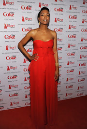Aisha Tyler wore a strapless red chiffon dress for the Heart Truth fashion show.