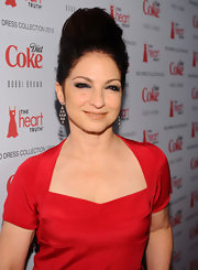 Gloria Estefan rocked a retro beehive hairdo at the Heart Truth's Red Dress Collection Fashion Show.