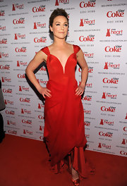 Elisabeth Rohm looked exquisite in this deep-plunging red gown for the Heart Truth fashion show.