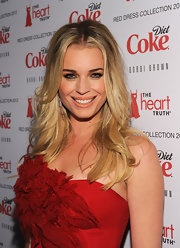 Rebecca Romijn attended the 2012 Heart Truth's Red Dress Fashion Show wearing her hair with a wavy tousled texture and casual center part.