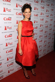 'Glamour' editor Cindi Leive accessorized her cocktail dress with re patent leather peep-toe pumps.