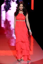 Denise Richards took to the stage in a red tiered halter neck gown with a sequined empire waist for The Heart Truth's Red Dress Collection. Her dark locks were worn down in thick curls.