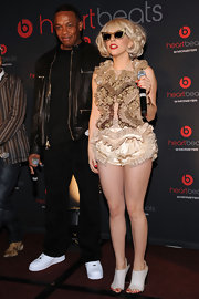 Lady Gaga paired her ruffled ensemble with peep toe slingback pumps.