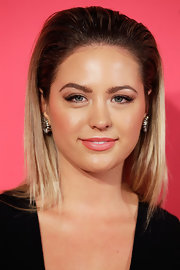 Jesinta opted for a super sleek 'do with major teasing at the crown.