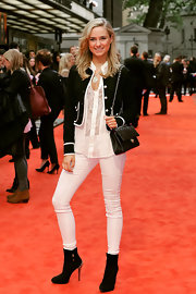 Kimberley Garner sported a black fitted jacket over her flowing white blouse and white skinny pants.