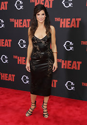 Sandra Bullock was edgy-glam at the premiere of 'The Heat' in a black Ermanno Scervino leather dress with sultry cutouts.