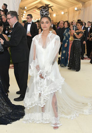 Sasha Lane gave us boudoir vibes with this sheer white gown by Tory Burch at the 2018 Met Gala.
