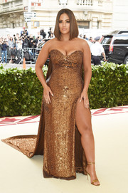 Ashley Graham worked her curves in a strapless gold sequin gown by Prabal Gurung at the 2018 Met Gala.