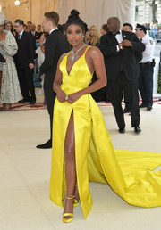 Gabrielle Union matched her dress with a pair of yellow platforms by Stuart Weitzman.