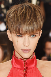 Ruby Rose attended the 2018 Met Gala wearing her hair in a bowl cut.