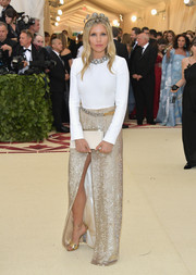 Sienna Miller glammed up her top with a long gold sequin skirt, also by Louis Vuitton.