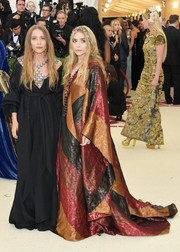 Ashley Olsen stuck to her trademark boho style in a color-block maxi dress by Paco Rabanne at the 2018 Met Gala.