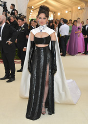 Eiza Gonzalez was a sexy superhero in a black and silver Prabal Gurung cutout gown with a flowing white cape at the 2018 Met Gala.