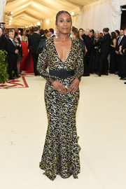 Issa Rae looked radiant in a black and gold sequin gown by Michael Kors at the 2018 Met Gala.