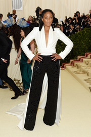 Tiffany Haddish went the menswear-glam route in a fitted white shirt with a long train at the 2018 Met Gala.