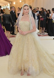 Kate Bosworth had a princess bride moment this gold-speckled, strapless ball gown by Oscar de la Renta at the 2018 Met Gala.